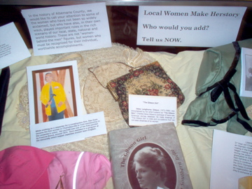 Image of               CNOW's display in the public library honoring local women